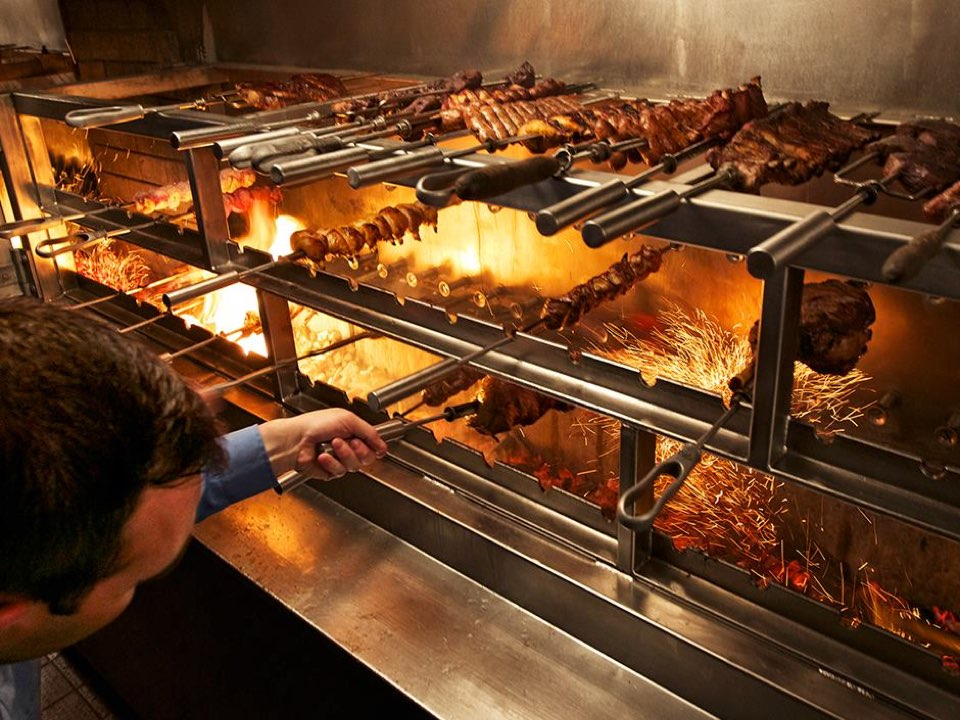 Brazilian steakhouse fogo de ch o sets grills ablaze dec for S kitchen steak house