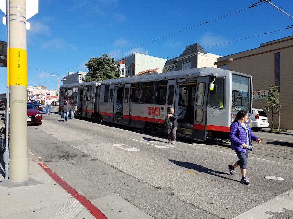 Passengers disembark from the l taraval at 30th avenue and taraval