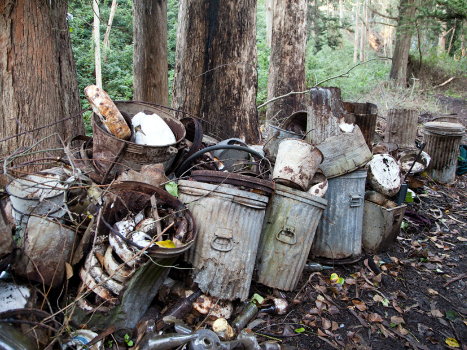 Trash, including an alley full of old bedpans, littered the property prior to SFUR's efforts
