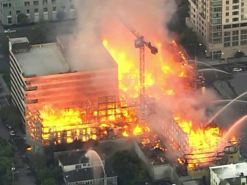 A massive fire is consuming a construction site in Oakland