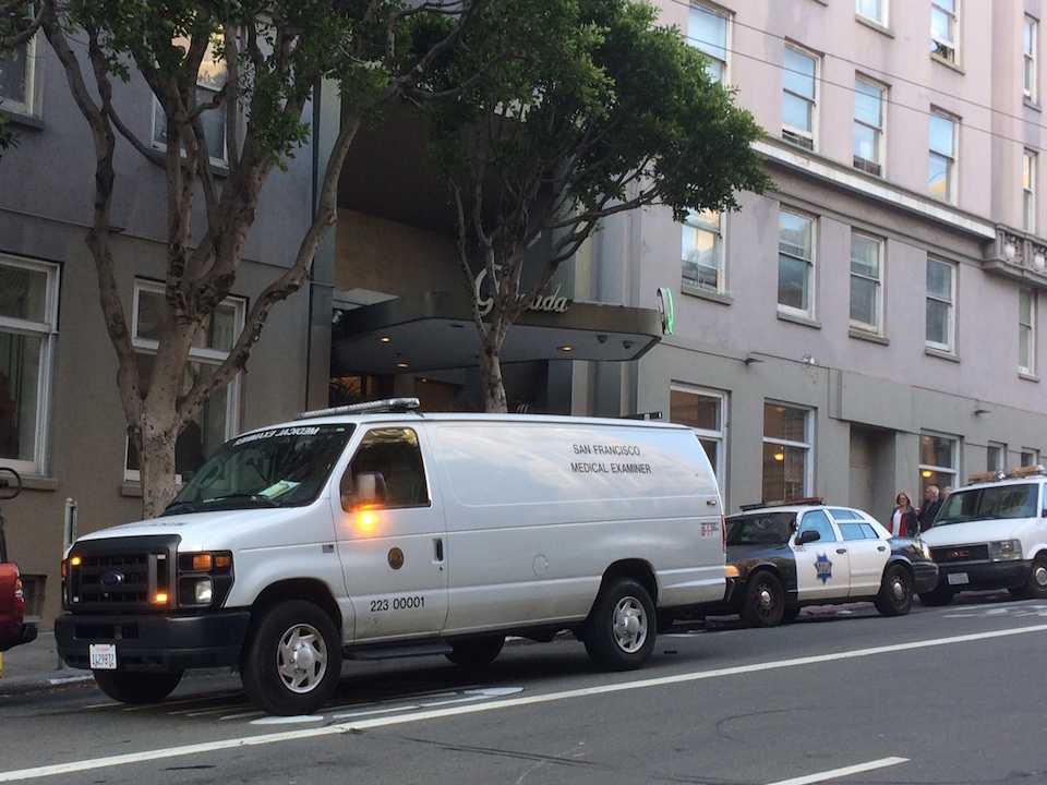 Sf medical examiner and cop car