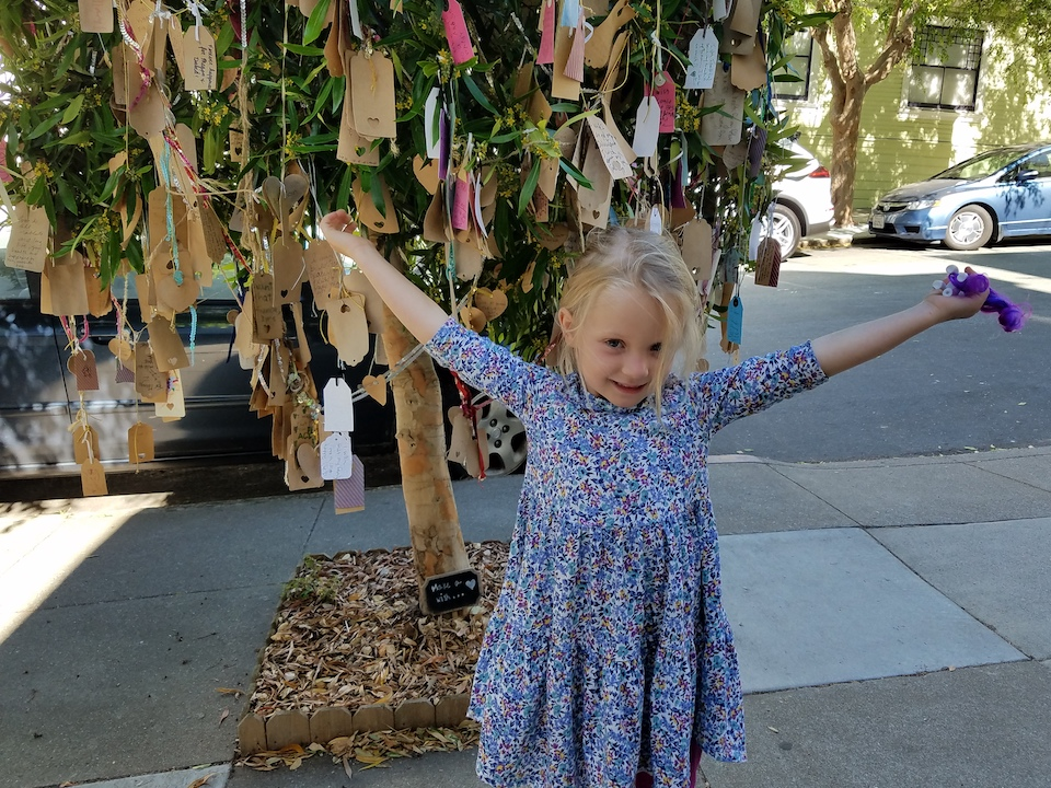 Cate in front of the wishing tree